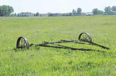 Rusty big old farming plough. Rural view