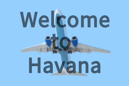 havana: Blurred background with passenger airplane. Inscription Welcome to Havana on the sky.