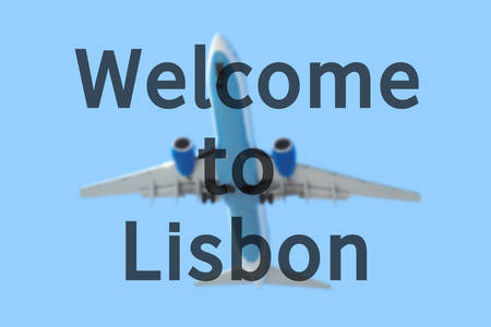lisbon: Blurred background with passenger airplane. Inscription Welcome to Lisbon on the sky.