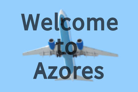 azores: Blurred background with passenger airplane. Inscription Welcome to Azores on the sky.