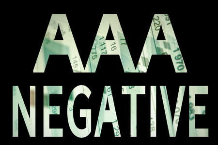 aaa: Inscription AAA negative on a PC screen. Financial data on background.