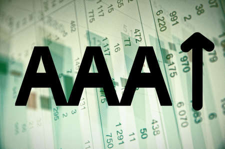 aaa: Inscription AAA and arrow on a PC screen. Financial data on background.