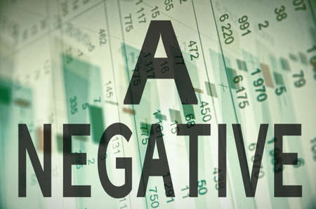 liabilities: Inscription A negative on a PC screen. Financial data on background. Stock Photo
