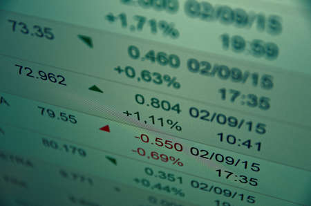 Financial data on a PC monitor. Trading terminal with quotes. Selective focus.