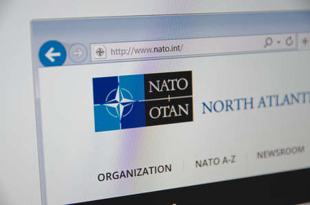 nato: Saransk, Russia - November 24, 2015: A computer screen shows details of NATO main page on its web site in Saransk, Russia, on November 24 2015. Selective focus.