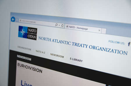 north atlantic treaty organization: Saransk, Russia - November 24, 2015: A computer screen shows details of NATO main page on its web site