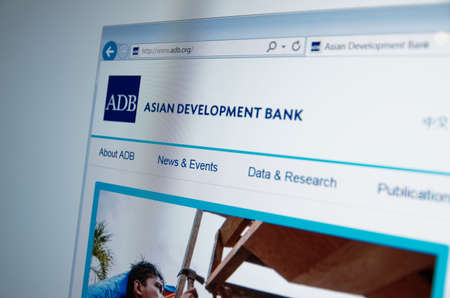 financial official: Saransk, Russia - CIRCA, 2015: A computer screen shows details of Asian Development Bank main page on its web site