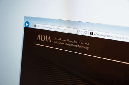 financial official: Saransk, Russia - CIRCA, 2015: A computer screen shows details of Abu Dhabi Investment Authority main page on its web site Editorial