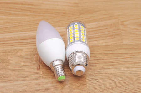 e27: LED candle E14 and E27 lamps on the wooden background. Stock Photo
