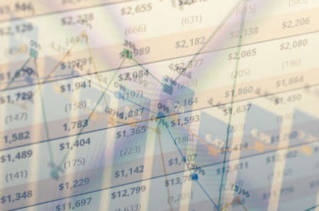 multiple exposure: Close-up computer screen with financial data. Multiple exposure photo. Stock Photo
