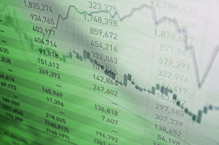 buy shares: Close-up computer screen with financial data. Multiple exposure photo. Stock Photo