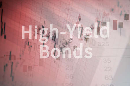 bonds: Inscription High-Yield Bonds on PC screen. Close-up computer screen with financial data. Multiple exposure photo. Stock Photo