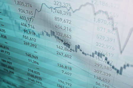 Close-up computer screen with financial data. Multiple exposure photo. Stockfoto
