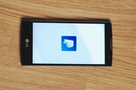 paypal: SARANSK, RUSSIA - March 23, 2016: Photo of LG Smartphone with PayPal logotype on the screen. Selective focus.