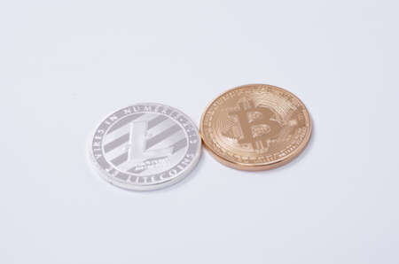 p2p: Saransk, Russia - CIRCA, 2016: Silver-plated Litecoin and Gold-plated Bitcoin on a white background.
