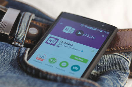 SARANSK, RUSSIA - April 3, 2016: Photo of Smartphone in a jeans pocket with Microsoft OneNote application in a Google Play Store on the screen. Редакционное