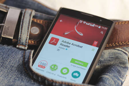 google play: SARANSK, RUSSIA - April 3, 2016: Photo of Smartphone in a jeans pocket with Adobe Acrobat Reader application in a Google Play Store on the screen.