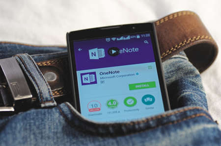 google play: SARANSK, RUSSIA - April 3, 2016: Photo of Smartphone in a jeans pocket with Microsoft OneNote application in a Google Play Store on the screen. Editorial