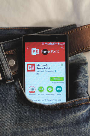 google play: SARANSK, RUSSIA - April 3, 2016: Photo of Smartphone in a jeans pocket with Microsoft PowerPoint application in a Google Play Store on the screen.