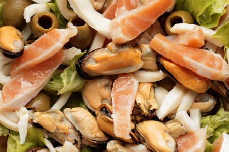 aquaculture: Aquaculture salad with red salmon fish, olives and lettuce. Stock Photo