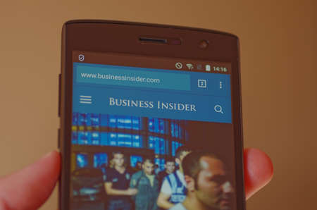 insider: SARANSK, RUSSIA - JULY 17, 2016: A smartphone screen shows Business Insider web site on the screen. Selective focus.