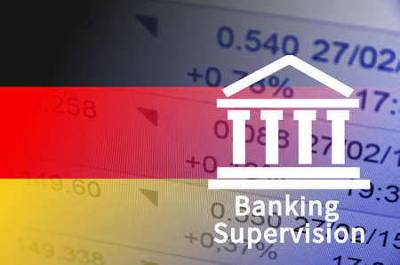 supervision: Building icon with inscription Banking Supervision. German flag, with the financial data in the background. Stock Photo