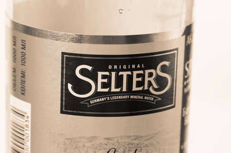 sodium bicarbonate: SARANSK, RUSSIA - AUGUST 31, 2016: Bottle of Selters water closeup. Selective focus. Sepia filter applied. Editorial