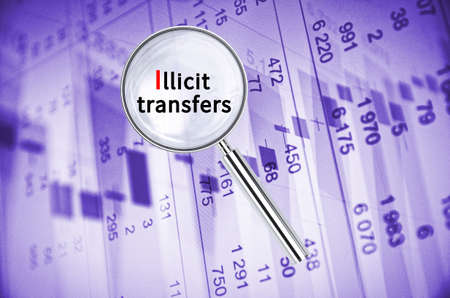transfers: Magnifying lens over background with text Illicit transfers, with the financial data visible in the background. 3D rendering.