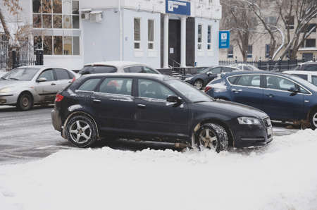 a3: SARANSK, RUSSIA - JANUARY 6, 2017: Audi A3 parked on city street. Photo taken at cloudy day.