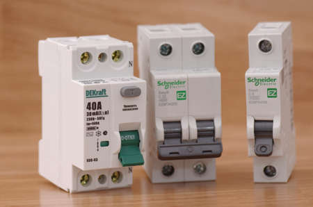 breakers: SARANSK, RUSSIA - JANUARY 13, 2017: DEKraft residual-current device, Schneider Electric two-pole and one-pole circuit breakers. Editorial