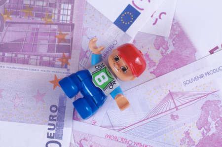 illustrative editorial: SARANSK, RUSSIA - June 03, 2017: Lego Man lay on a fake 500 Euro bills. Editorial