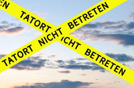 do: Tatort nicht betreten (Crime Scene Do Not Enter) Barrier Tape Cross Stock Photo