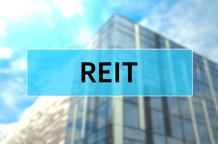REIT written on translucent blue space.