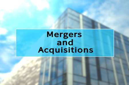 Mergers and acquisitions (M&A) written on translucent blue space. Stock Photo