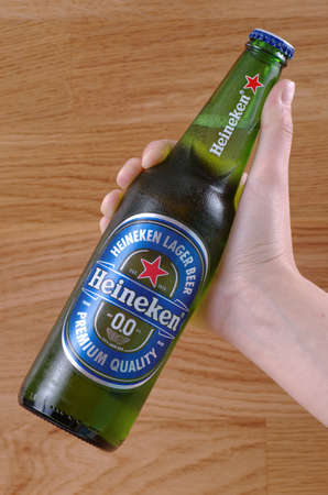 SARANSK, RUSSIA - JUNE 07, 2017: Bottle of Non-alcoholic version of Heineken 0.0 beer in hand. Editorial