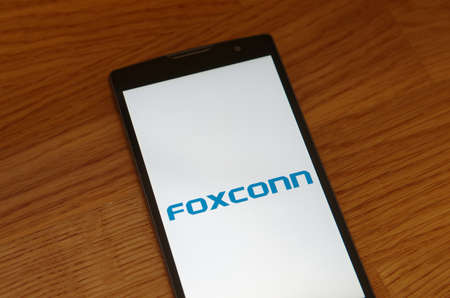 Saransk, Russia - July 23, 2017: A Smartphone screen shows logo of Foxconn.