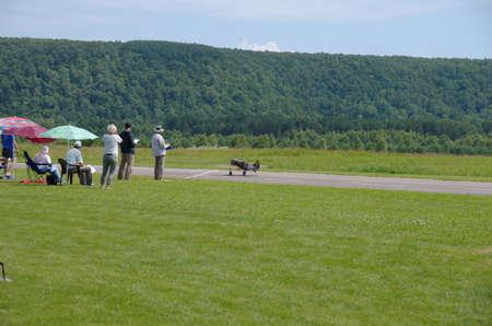 PENZA OBLAST, RUSSIA - JULY 15, 2017: Radio control flying model of World War II era before take-off. The Russian Aeromodelling Cup in Bolshoy Vyas village.