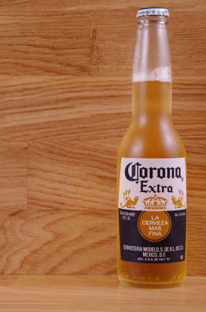 SARANSK, RUSSIA - AUGUST 16, 2017: Corona Extra beer on wooden background. Editorial
