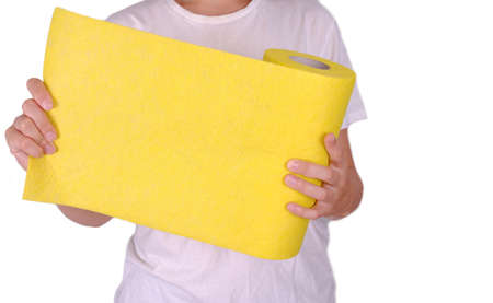 Woman hold roll of yellow non woven fabric.