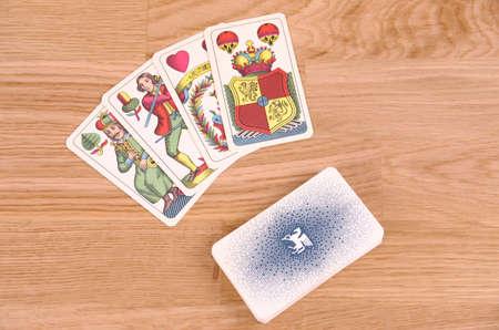 SARANSK, RUSSIA - SEPTEMBER 05, 2017: Tarot cards on wooden table.