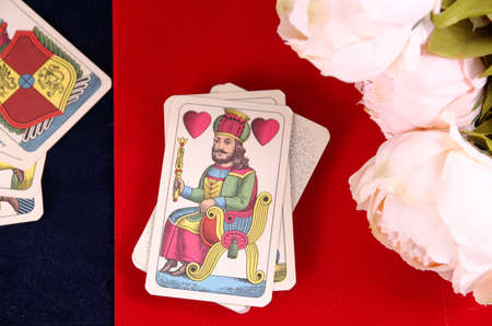 SARANSK, RUSSIA - SEPTEMBER 05, 2017: Tarot cards with peony flowers on velvet.