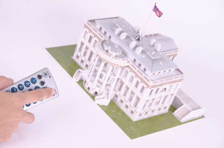 SARANSK, RUSSIA - SEPTEMBER 05, 2017: The remote control is aimed at the 3D puzzle of the White House. Editöryel