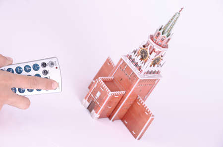 SARANSK, RUSSIA - SEPTEMBER 05, 2017: The remote control is aimed at the 3D puzzle of the Spasskaya Tower. Editöryel