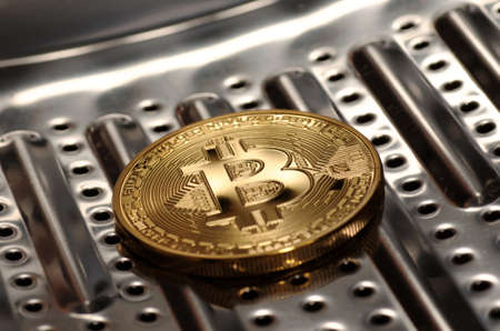 Bitcoin in washing machine drum. Money laundering concept.