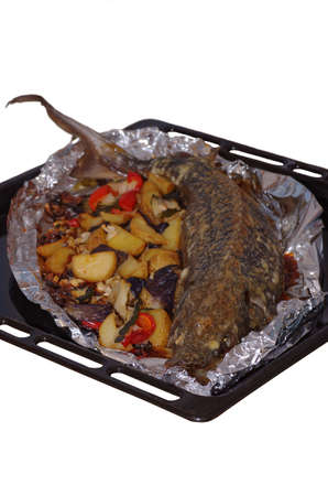 Sturgeon baked with vegetables.