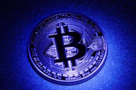 Golden plated Bitcoin under ultraviolet (UV) light.
