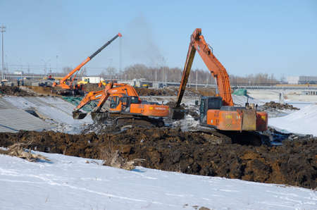 SARANSK, RUSSIA - MARCH 10, 2018: Excavator Cleaning Canal.