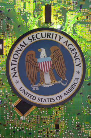 SARANSK, RUSSIA - MARCH 21, 2018: The National Security Agency seal printed on a paper and placed at circuit board. Editorial
