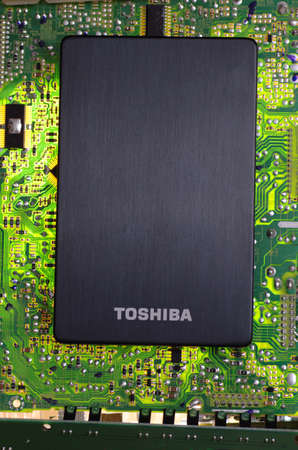 SARANSK, RUSSIA-MARCH 18, 2018: External hard drive produced by Toshiba on circuit broad. Editorial