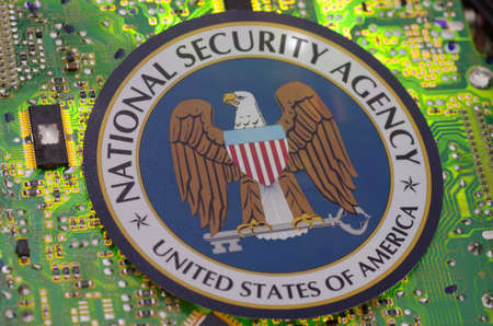 SARANSK, RUSSIA - MARCH 21, 2018: The National Security Agency, seal printed on paper and placed at circuit board.